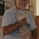Jason holding baby Nia tiger.